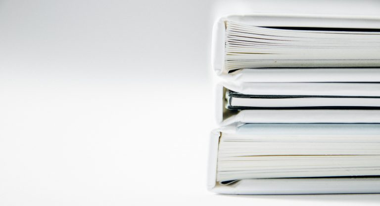 Stack of white folders to the right of the image